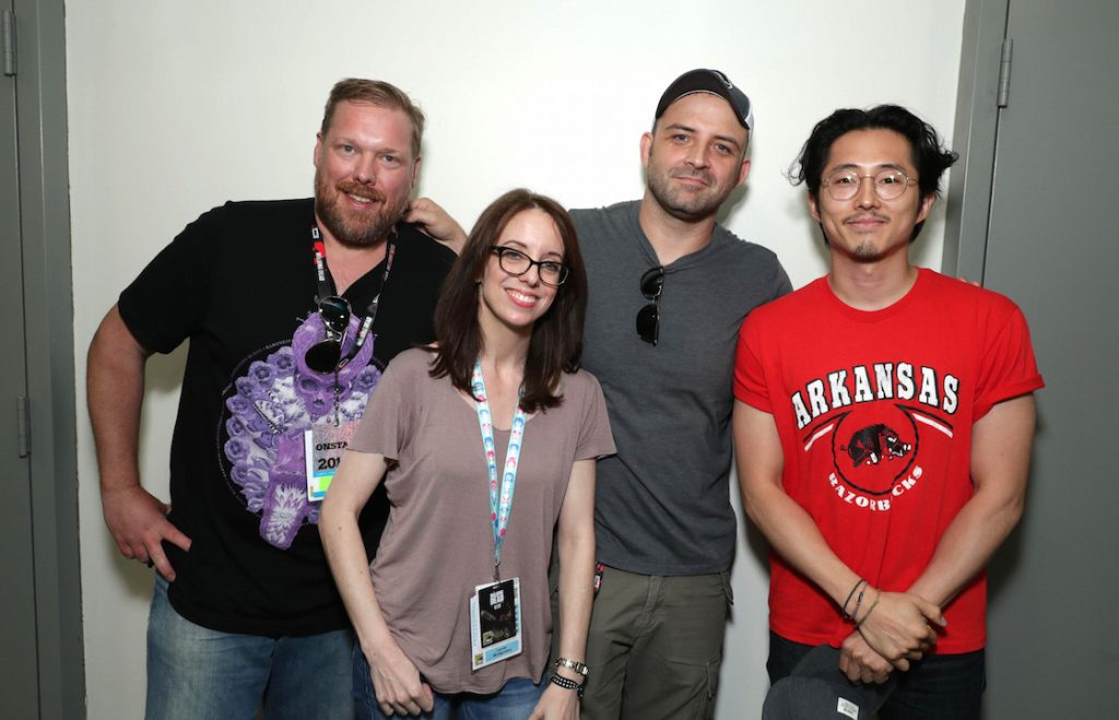 """Writer Tim Hedrick, Director Lauren Montgomery, Director Joaquim Dos Santos and Steven Yeun seen at DreamWorks Animation """"Voltron"""" Panel at 2016 Comic-Con on Thursday, July 21, 2016, in San Diego, Calif. (Photo by Eric Charbonneau/Invision for DreamWorks Animation/AP Images)"""