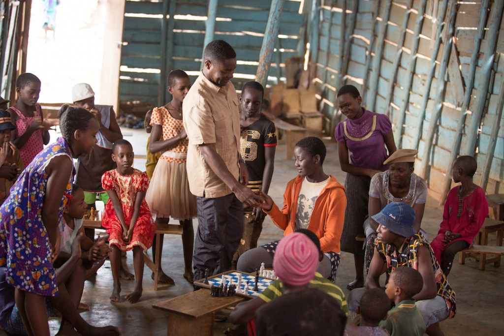 Teacher teaching the kids to play chess in Queen of Katwe