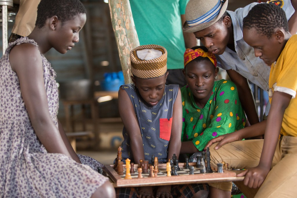 Learning to play chess in Queen of Katwe