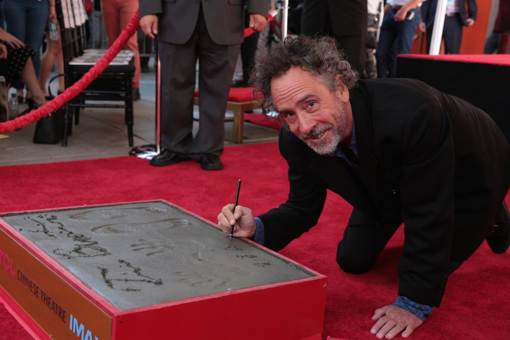 Tim Burton signing his plaque at the TLC Chinese Theatre
