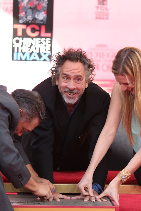 Tim Burton getting his hand print on the walk of fame