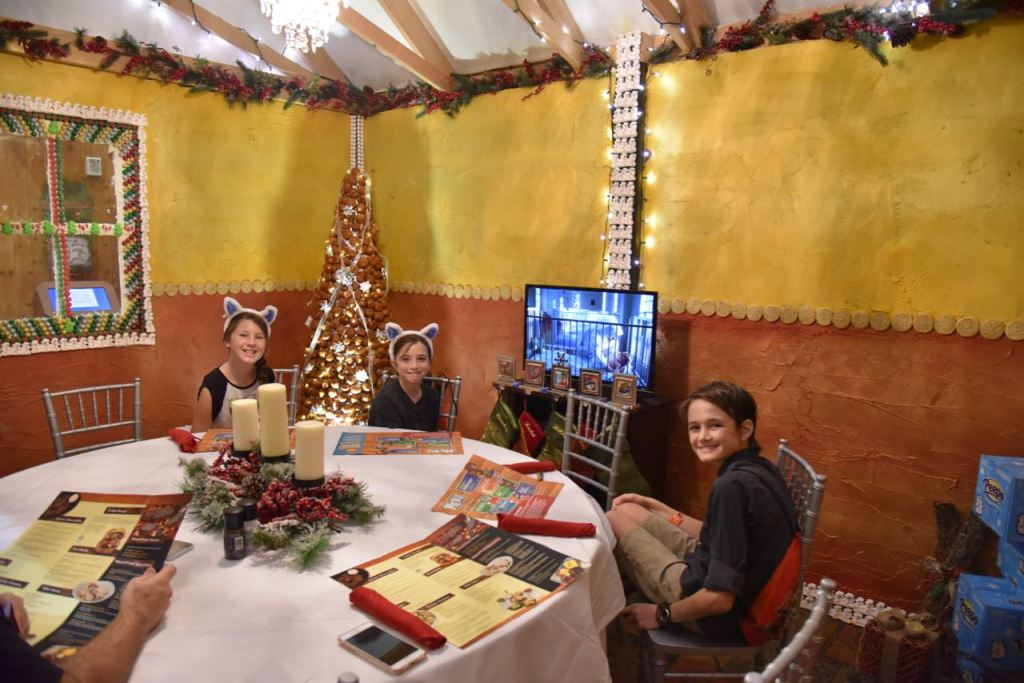 Family dining inside of a Gingerbread House