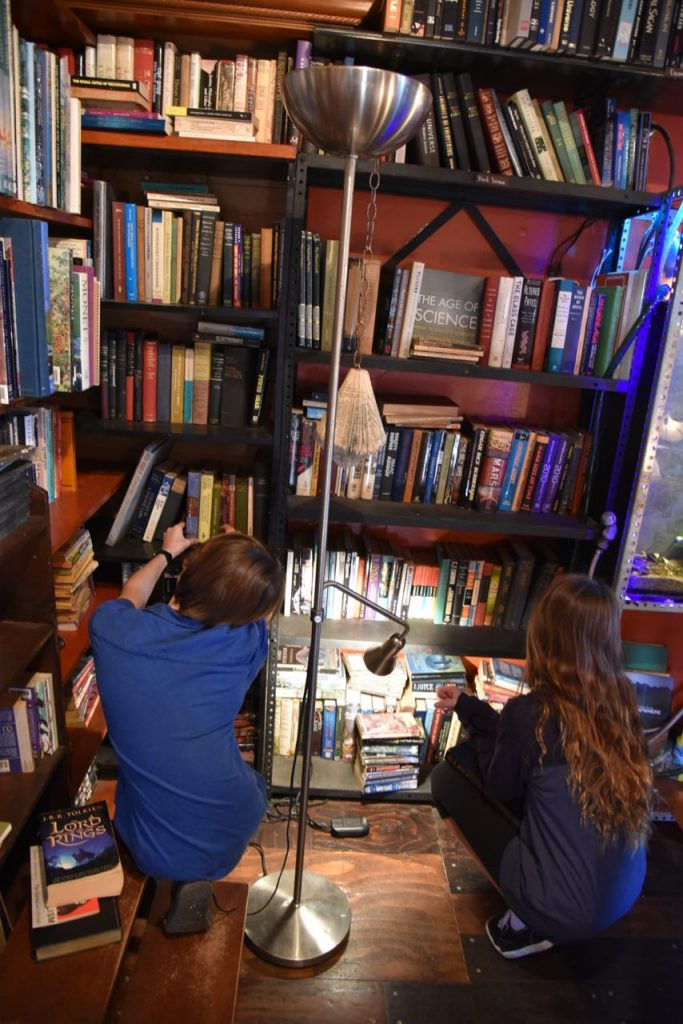Children looking for books at Lhooq Bookstore