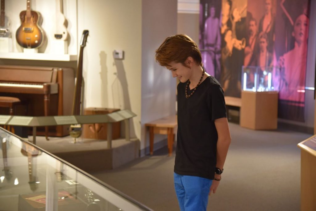 Looking at the different instruments at the Museum of Making Music