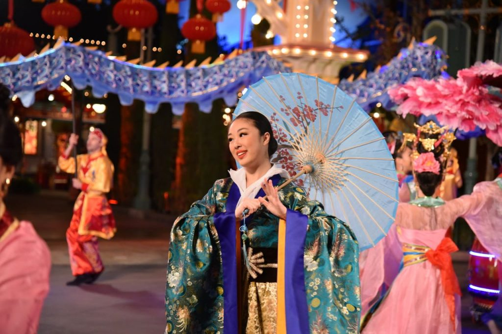 Umbrella dancer at the Mulan performance at Disneyland