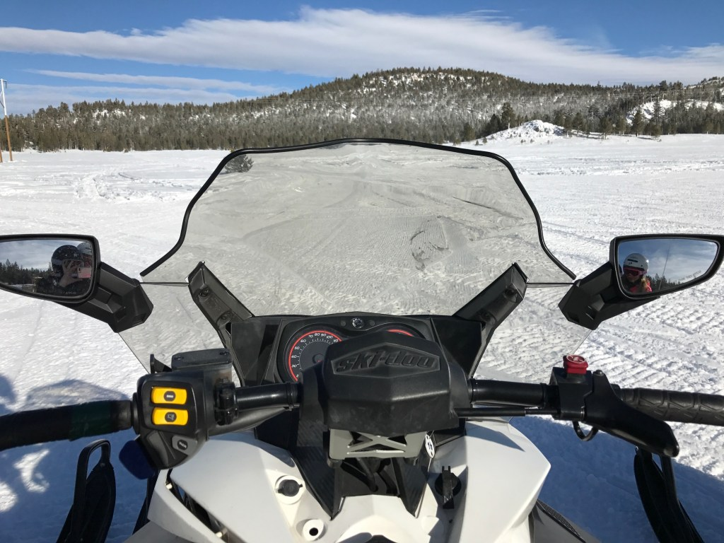Getting ready to ride a snowmobile for the first time