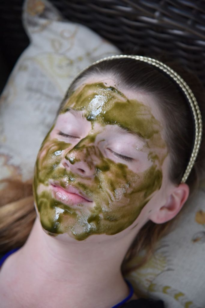 Teenager using the Inlight Organic Super Food Face Mask