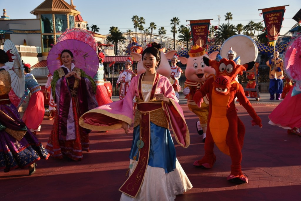 Mulan and Mushu in Mulan's Lunar New Year Procession