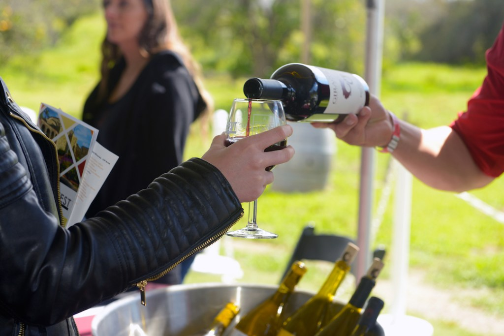 Pouring wine at the OC Wine Fest