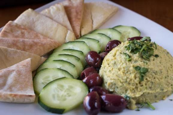 One of the new starters is fresh house-made hummus served with kalamata olives and pita bread. Photo courtesy of PdM