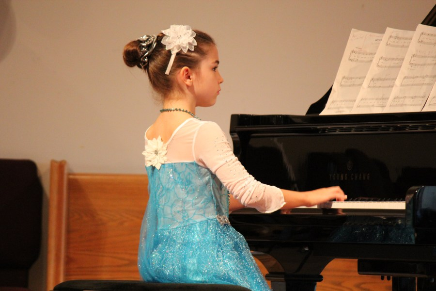 Young girl playing piano | Piano Lessons Oconee