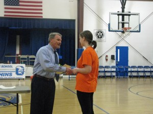 All 'A' student Samantha Styron receives her certificate from principal Walt Padgett. Photo by P. Vankevich