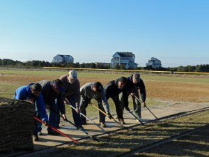 Volunteers laying sod PS
