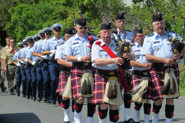 The procession includes the U.S. Coast Guard Pipe Band, the U.S. Coast Guard Honor Guard, and the Ocracoke Boy Scout and Girl Scout troops. Photo by C. Leinbach
