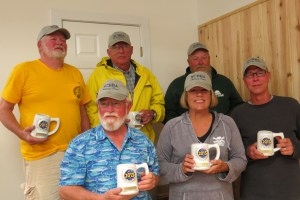 """The North Carolina Beach Buggy Association is the second place overall winners. Bill Smith, front right, caught the largest fish Friday, a 30 1/4"""" drum."""