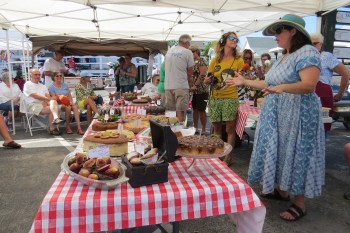 The display of 15 innovative and 13 original fig cakes prior to judging. Daphne Bennink is center and Sundae Horn, event coordinator, is at right.