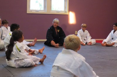 Gustavo Sanchez takes is budding judo practitioners through warms up prior to class in Angie's Gym, along Sand Dollar Road. Photo by C.