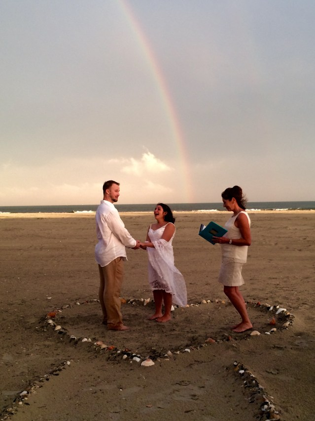 Brian Horner and Molly Brumfield get married under a double rainbow July 11. Officiant is Bonnie Williams of Hatteras Village.Photo by Betty Dixon