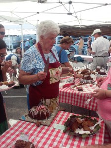Joyce Spencer keeps active in her retirement by helping with events, such as slicing fig cakes at the Fig Cake Bake-Off in August. Photo by Robin Payne.