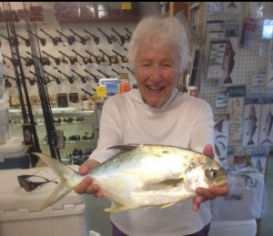 Doris Winslow Williams, 94, of Greenville, stays active fishing with her daughter, islander Ruth Toth. Miss Doris received her first citation for this 2-pound, 1-ounce pompano she caught in August. Photo courtesy of Tradewinds Tackle Shop.