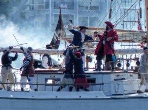 Blackbeard and Lt. Robert Maynard battle it out on Silver Lake at last year's Blackbeard's Pirate Jamboree on Ocraocke.