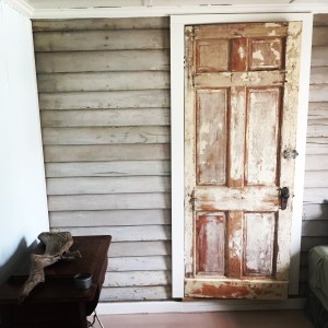"David Senseney donated one of the original Community Store doors for ""a sammich."" The door accents a found interior wall that is actually the 102-year-old exterior lap siding of the original house, which had an existing door frame."