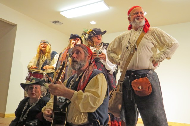 The Motley Tones, pirate minstrels, provide the soundtrack of the jamboree.