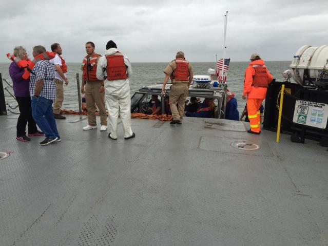 The U.S. Coast Guard evacuates passengers from the ferry, M/V Roanoke, which ran aground this morning en route from Ocracoke to Hatteras. Photo by Greg Capell