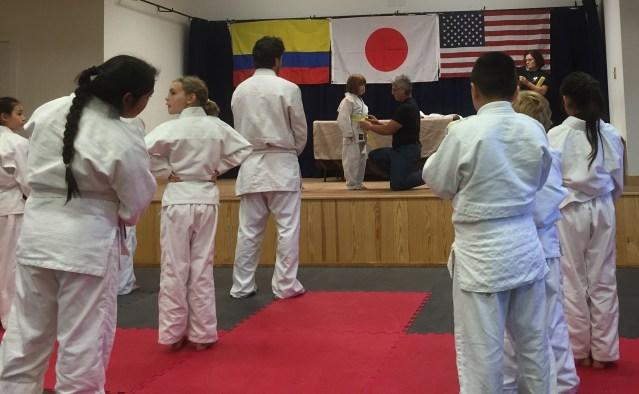 Zoe Modlin gets her yellow belt.