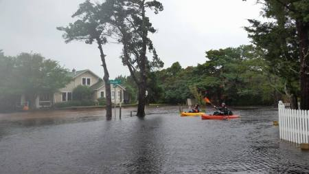 Kayaking in the flood waters near Ocracoke Coffee Co.