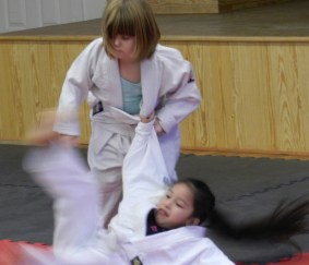 Zoe Modlin demonstrates her skills with Jamileth Martinez.