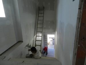 Nasho Villenueva and Juan Gutierrez repaint the main stairwell.