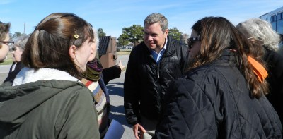 Rep. Paul Tine greets islanders. Photo by C. Leinbach