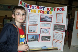Fourht grader Christian Stevens showed how high-powered magnets can be used in transportion and is insprired to study this in college. Photo by P. Vankevich