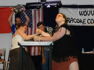 Kim Hansen, aka 'Wrestles with Bears,' right, takes down 'The Ripped Reader.'