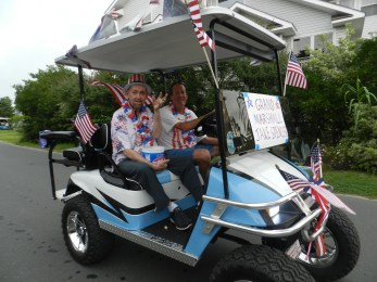Jakie Spencer is the July 4 parade grand marshal with Woody Billings driving. Photo by C. Leinbach