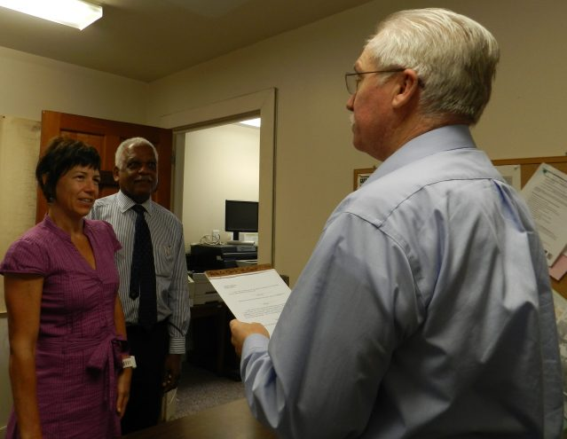 Islander Angie Todd, center, is sworn in as the Ocracoke member of the Hyde County school board by Magistrate Lonnie Burrus. Hyde County School District Superintendent Randolph Latimore witnesses the induction.