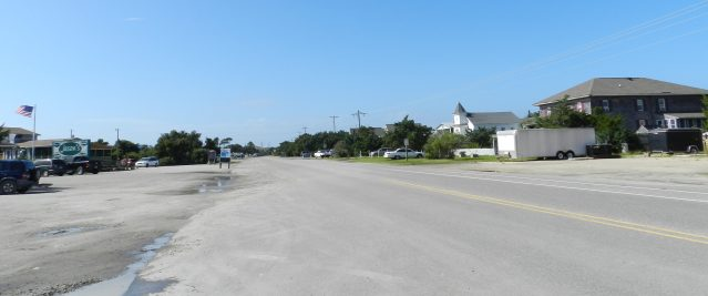 Ocracoke's usually busy main street, Irvin Garrish Highway, is practically deserted Wednesday as the evacuation of visitors had begun. Photo: C. Leinbach