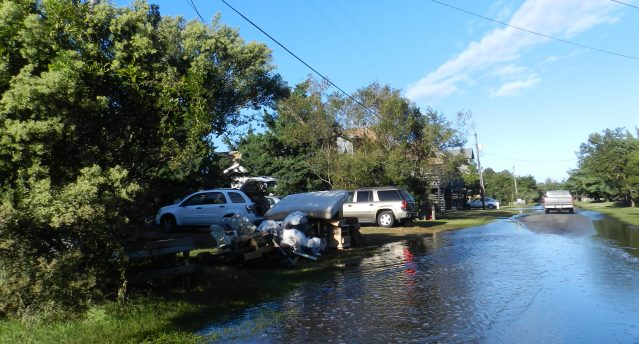 Islanders clean up Tuesday after Matthew. Photo: C. Leinbach