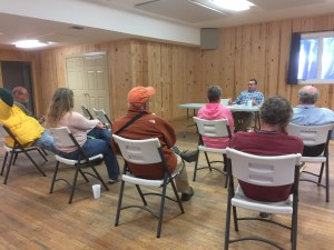 Islanders meet Monday in the Ocracoke Community Center with Chris Bock, operations manager at the Hatteras Ferry dock. Photo: C. Leinbach