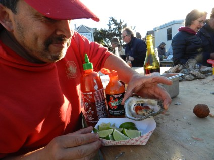 Eduardo Chavez adds lime, hot sauce and double-hot sauce to his oysters. Photo: C. Leinbach