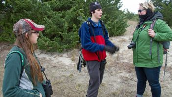 Marky Mutchler and Matt Janson chat with Crystal Canetbury on the Portmouth Island Christmas Bird Count. Photo by P. Vankevich
