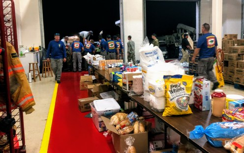 Volunteers load donated food and water Saturday night, Sept. 7, 2019, into the Ocracoke Volunteer Fire Department, which by Sept. 23 was totally full. Photo: C. Leinbach