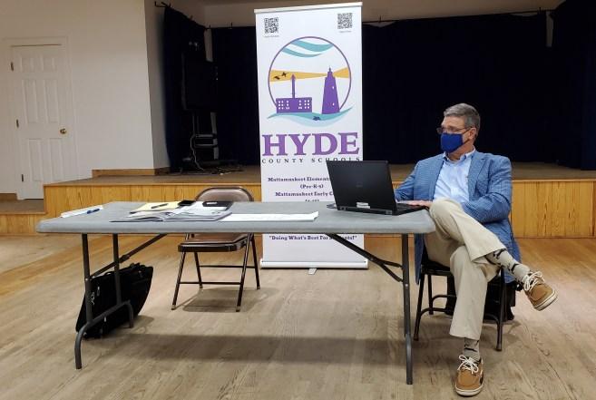 Hyde Superintendent Steve Basnight monitors the new Ocracoke School presentation. Photo by Richard Taylor