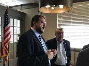 Ocean County Prosecutor Bradley Billhimer, left, speaks with local officials after a meeting of the Ocean County Mayors' Association at the Cove restaurant in Toms River, one of which is former Pine Beach mayor (current Toms River board president) Russell Corby. (Photo by Chris Lundy)