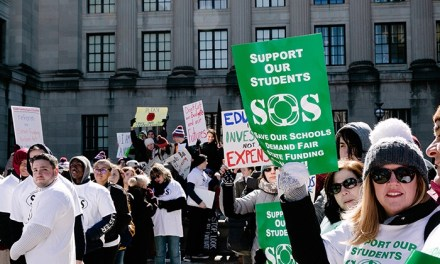 Protesters: Cuts In Aid Mean Cuts In Staff, Programs