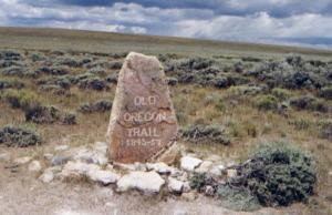 an engraved Oregon Trail stone trail marker in open landscape at South Pass, Wyoming