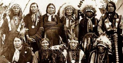 group of Native American men posing and dressed in Plains style clothing