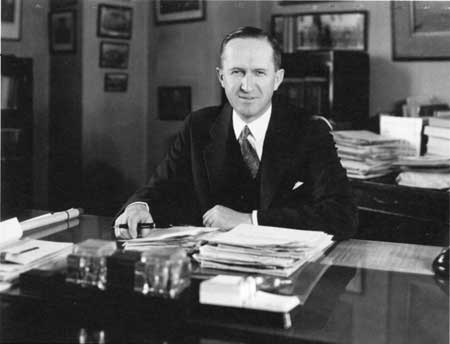 Horace M. Albright sitting at a desk with paperwork