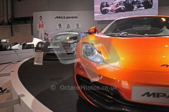 World © Octane Photographic 2010. © Octane Photographic 2011. Autosport International 2011. McLaren display. MP4/12C and F1. Digital ref : 0026CB1D5203